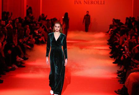 KYIV, UKRAINE - FEBRUARY 5, 2018: Models present a creation by designer Iva Nerolli during 42nd Ukrainian Fashion Week season FallWinter 201819 at Mystetskyi Arsenal in Kyiv, Ukraine Editorial