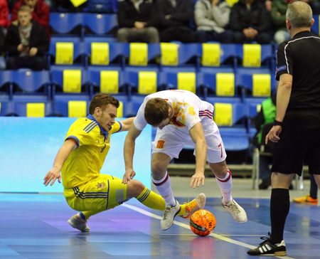 KYIV, UKRAINE - JANUARY 28, 2017: Petro Shoturma of Ukraine (L) fights for a ball with Pola of Spain during their Friendly Futsal match at Palats of Sports in Kyiv, Ukraine