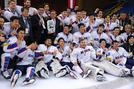 KYIV, UKRAINE - APRIL 28, 2017: Team of South Korea, silver medalist of the IIHF 2017 Ice Hockey World Championship Div 1A, pose for a group photo at Palace of Sports in Kyiv, Ukraine Editorial