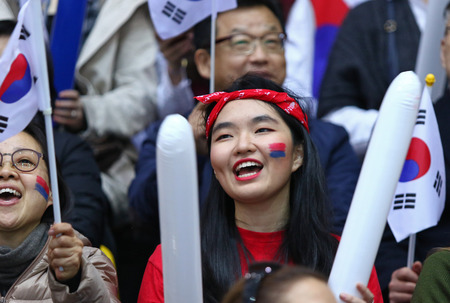KYIV, UKRAINE - APRIL 28, 2017: South Korean fans show their support during IIHF 2017 Ice Hockey World Championship Div 1 Group A game against Ukraine at Palace of Sports in Kyiv, Ukraine Editorial