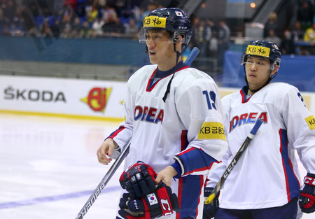 KYIV, UKRAINE - APRIL 28, 2017: Sangwook KIM (Left) and Jin Hui AHN of South Korea in action during IIHF 2017 Ice Hockey World Championship Div 1 Group A game against Ukraine at Palace of Sports Editorial
