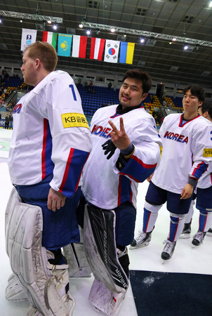 KYIV, UKRAINE - APRIL 28, 2017: Goalkeepers Matt DALTON (Left) and Sungje PARK of South Korea smile after IIHF 2017 Ice Hockey World Championship Div 1 Group A game against Ukraine at Palace of Sports Editorial