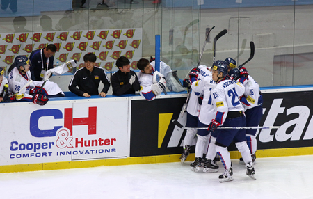 KYIV, UKRAINE - APRIL 28, 2017: Players of South Korea celebrate after scores ageinst Ukraine at their the IIHF 2017 Ice Hockey World Championship Div 1 Group A game at Palace of Sports in Kyiv Editorial