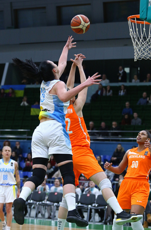 KYIV, UKRAINE - FEBRUARY 14, 2018: Taisiia Udodenko of Ukraine (L) fights for a ball with Chatilla van Grinsven of Netherlands during their FIBA Womens EuroBasket 2019 game at Palace of Sports in Kyiv Redakční