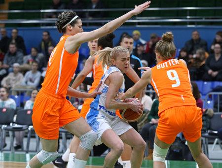 KYIV, UKRAINE - FEBRUARY 14, 2018: Arina Bilotserkivska of Ukraine (in White) in action during FIBA Womens EuroBasket 2019 game Ukraine v Netherlands at Palace of Sports in Kyiv. Ukraine won 84-49