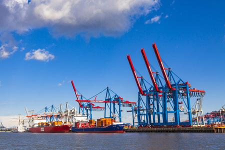 HAMBURG, GERMANY - JUNE 25, 2014: Docks of Port of Hamburg (Hamburger Hafen) on the river Elbe, Germany. The largest port in Germany and one of the busiest ports in Europe Editöryel