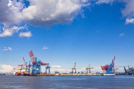 HAMBURG, GERMANY - JUNE 25, 2014: Docks of Port of Hamburg (Hamburger Hafen) on the river Elbe, Germany. The largest port in Germany and one of the busiest ports of Europe
