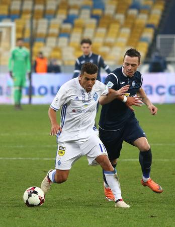 KYIV, UKRAINE - FEBRUARY 18, 2018: Ukrainian Premier League game FC Dynamo Kyiv v Olimpik Donetsk. Junior Moraes (L, Dynamo Kyiv) and Ruslan Kisil (Olimpik). NSC Olympic stadium in Kyiv