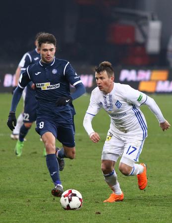 KYIV, UKRAINE - FEBRUARY 18, 2018: Ukrainian Premier League game FC Dynamo Kyiv v Olimpik Donetsk. Ruslan Kisil (L, Olimpik) and Ruslan Rotan (Dynamo Kyiv). NSC Olympic stadium in Kyiv Editorial