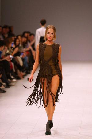 KYIV, UKRAINE - FEBRUARY 3, 2018: Models present a creation by designer DOMANOF during 42nd Ukrainian Fashion Week season FallWinter 201819 at Mystetskyi Arsenal in Kyiv, Ukraine