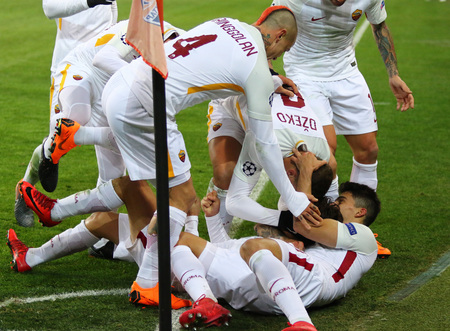 KHARKIV, UKRAINE - FEBRUARY 21, 2018: AS Roma players celebrate after scored a goal during UEFA Champions League Round of 16 game against Shakhtar Donetsk at OSK Metalist stadium in Kharkiv Editorial