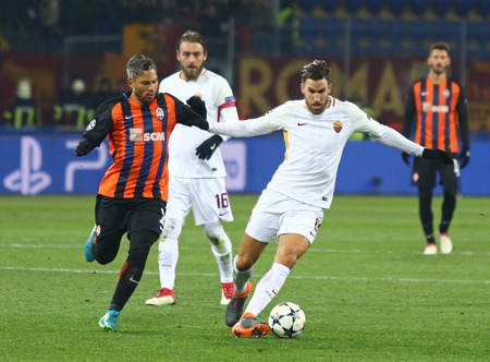 KHARKIV, UKRAINE - FEBRUARY 21, 2018: Kevin Strootman of AS Roma (R) fights for a ball with Marlos of Shakhtar Donetsk during their UEFA Champions League Round of 16 game at Metalist stadium