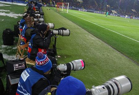 KHARKIV, UKRAINE - FEBRUARY 21, 2018: Sport photographers at work during UEFA Champions League Round of 16 game Shakhtar v Roma at OSK Metalist stadium in Kharkiv, Ukraine Foto de archivo - 97173615