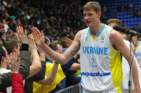 KYIV, UKRAINE - FEBRUARY 26, 2018: Ukrainian basketball players thank their fans after FIBA World Cup 2019 European Qualifiers game against Sweden at Palace of Sports in Kyiv. Ukraine won 77-66