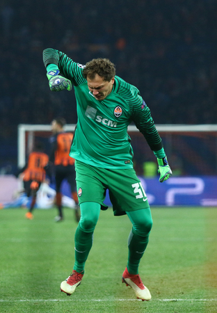KHARKIV, UKRAINE - FEBRUARY 21, 2018: Goalkeeper Andriy Pyatov of Shakhtar Donetsk reacts after Shakhtar scored a goal against AS Roma during their UEFA Champions League Round of 16 game