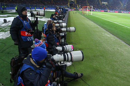 KHARKIV, UKRAINE - FEBRUARY 21, 2018: Football photographers at work during UEFA Champions League Round of 16 game Shakhtar v Roma at OSK Metalist stadium in Kharkiv, Ukraine Foto de archivo - 97174337