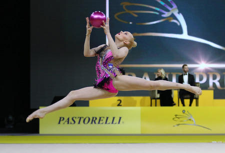 KYIV, UKRAINE - MARCH 16, 2018: Rhythmic gymnast Aleksandra Podgorsek of Slovenia performs with Ball during Rhythmic Gymnastics Grand Prix Standard-Bild - 100236872