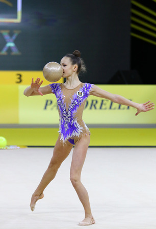 KYIV, UKRAINE - MARCH 16, 2018: Rhythmic gymnast Anastasia Zacrevschi of Moldova performs with Ball during Rhythmic Gymnastics Grand Prix Editorial