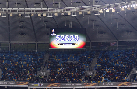 KYIV, UKRAINE - MARCH 15, 2018: Scoreboard of NSK Olimpiyskyi stadium in Kyiv with attendance of the UEFA Europa League game FC Dynamo Kyiv v Lazio. Total attendance of NSK Olimpiyskyi is 70 050