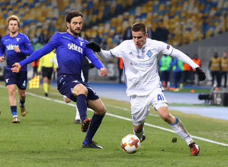 KYIV, UKRAINE - MARCH 15, 2018: Artem Besedin of Dynamo Kyiv (R) fights for a ball with Marco Parolo of SS Lazio during their UEFA Europa League Round of 16 game at NSK Olimpiyskyi stadium in Kyiv