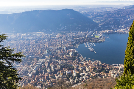 Aerial landscape of the picturesque colourful City of Como on Lake Como, Italy. European Alps on the background. European vacation, living life style, travel concept