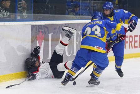 KYIV, UKRAINE - APRIL 14, 2018: IIHF 2018 Ice Hockey U18 World Championship Div 1 Group B game Ukraine (Blue jersey) v Japan (White jersey) at Palace of Sports in Kyiv, Ukraine. Japan won 1-0