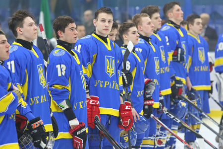 KYIV, UKRAINE - APRIL 14, 2018: Players of Ukraine National Team during the IIHF 2018 Ice Hockey U18 World Championship Div 1 Group B game against Japan at Palace of Sports in Kyiv, Ukraine