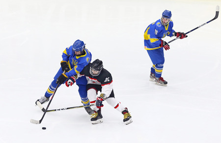 KYIV, UKRAINE - APRIL 14, 2018: IIHF 2018 Ice Hockey U18 World Championship Div 1 Group B game Ukraine (Blue jersey) v Japan (White jersey) at Palace of Sports in Kyiv, Ukraine. Japan won 1-0
