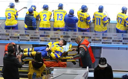 KYIV, UKRAINE - APRIL 17, 2018: Hlib Krivoshapkin of Ukraine lies on stretchers after injured during the IIHF 2018 Ice Hockey U18 World Championship Div 1 Group B game against Hungary Editorial