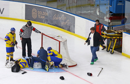 KYIV, UKRAINE - APRIL 17, 2018: Goalkeeper Artur Ohandzhanyan of Ukraine lies on ice after injured during the IIHF 2018 Ice Hockey U18 World Championship Div 1 Group B game against Hungary