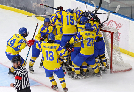 KYIV, UKRAINE - APRIL 17, 2018: Players of Ukraine National Team celebrate the victory after the IIHF 2018 Ice Hockey U18 World Championship Div 1 Group B game against Hungary at Palace of Sports