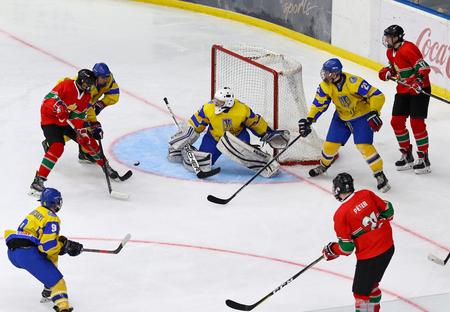 KYIV, UKRAINE - APRIL 17, 2018: IIHF 2018 Ice Hockey U18 World Championship Div 1 Group B game Ukraine (Yellow jersey) v Hungary (Red jersey) at Palace of Sports in Kyiv, Ukraine. Ukraine won 4-3