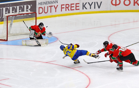 KYIV, UKRAINE - APRIL 17, 2018: Dmytro DANYLENKO of Ukraine (in yellow) scores a goal during the IIHF 2018 Ice Hockey U18 World Championship Div 1 Group B game against Hungary at Palace of Sports Editorial