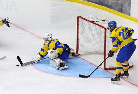 KYIV, UKRAINE - APRIL 17, 2018: Goalkeeper Artur Ohandzhanyan of Ukraine in action during the IIHF 2018 Ice Hockey U18 World Championship Div 1 Group B game against Hungary at Palace of Sports Editorial