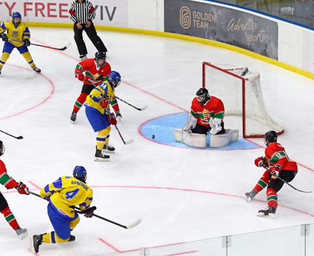 KYIV, UKRAINE - APRIL 17, 2018: IIHF 2018 Ice Hockey U18 World Championship Div 1 Group B game Ukraine (Yellow jersey) v Hungary (Red jersey) at Palace of Sports in Kyiv, Ukraine. Ukraine won 4-3