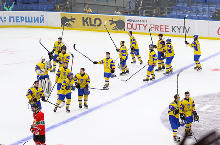 KYIV, UKRAINE - APRIL 17, 2018: Players of Ukraine National Team thank their fans after the IIHF 2018 Ice Hockey U18 World Championship Div 1 Group B game against Hungary at Palace of Sports in Kyiv