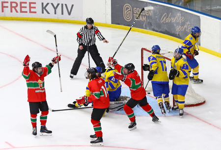 KYIV, UKRAINE - APRIL 17, 2018: Players of Hungary National Team reacts after scored a goal during the IIHF 2018 Ice Hockey U18 World Championship Div 1B game against Ukraine at Palace of Sports