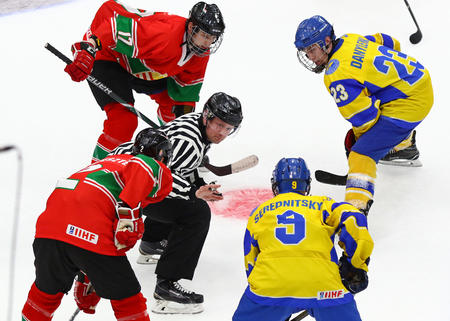 KYIV, UKRAINE - APRIL 17, 2018: Referee face-off the rink during the IIHF 2018 Ice Hockey U18 World Championship Div 1B game Ukraine v Hungary at Palace of Sports in Kyiv, Ukraine. Ukraine won 4-3