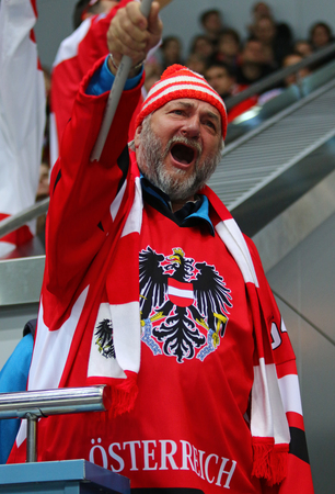 KYIV, UKRAINE - APRIL 24, 2017: Austrian fan shows his support during IIHF 2017 Ice Hockey World Championship Div 1 Group A game against Hungary at Palace of Sports in Kyiv, Ukraine