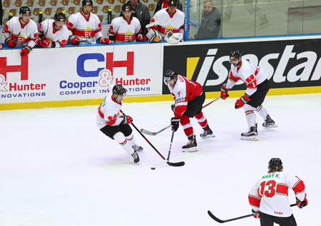 KYIV, UKRAINE - APRIL 24, 2017: Hungarian players (in White) fight for a puck with Austrian players during their IIHF 2017 Ice Hockey World Championship Div 1 Group A game at Palace of Sports in Kyiv
