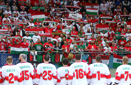 KYIV, UKRAINE - APRIL 24, 2017: Hungarian fans show their support during IIHF 2017 Ice Hockey World Championship Div 1 Group A game against Austria at Palace of Sports in Kyiv, Ukraine Editorial