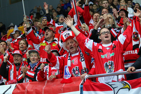 KYIV, UKRAINE - APRIL 24, 2017: Austrian fans show their support during IIHF 2017 Ice Hockey World Championship Div 1 Group A game against Hungary at Palace of Sports in Kyiv, Ukraine