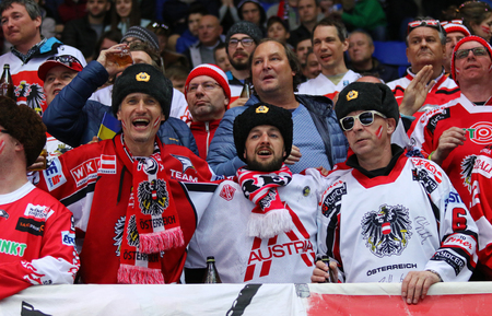 KYIV, UKRAINE - APRIL 25, 2017: Austrian fans show their support during IIHF 2017 Ice Hockey World Championship Div 1 Group A game against Ukraine at Palace of Sports in Kyiv, Ukraine. Austria won 1-0