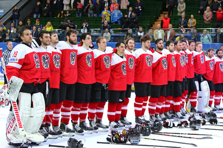 KYIV, UKRAINE - APRIL 25, 2017: Austrian players listen to National anthem after the IIHF 2017 Ice Hockey World Championship Div 1A game against Ukraine at Palace of Sports in Kyiv. Austria won 1-0