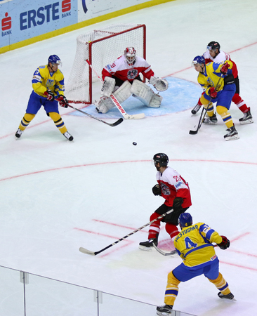 KYIV, UKRAINE - APRIL 25, 2017: Ukrainian ice-hockey players (Yellow jersey) fight for a puck with Austrian players (Red jersey) during their IIHF 2017 Ice Hockey World Championship Div 1 Group A game Editorial