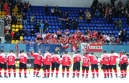 KYIV, UKRAINE - APRIL 25, 2017: Austrian players thank fans after the IIHF 2017 Ice Hockey World Championship Div 1A game against Ukraine at Palace of Sports in Kyiv. Austria won 1-0