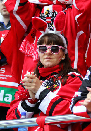 KYIV, UKRAINE - APRIL 25, 2017: Austrian fan show her support during IIHF 2017 Ice Hockey World Championship Div 1 Group A game against Ukraine at Palace of Sports in Kyiv, Ukraine. Austria won 1-0