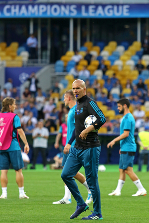 KYIV, UKRAINE - MAY 25, 2018: Real Madrid head coach Zinedine Zidane looks on during training session before UEFA Champions League Final 2018 game against Liverpool at NSC Olimpiyskiy Stadium in Kyiv