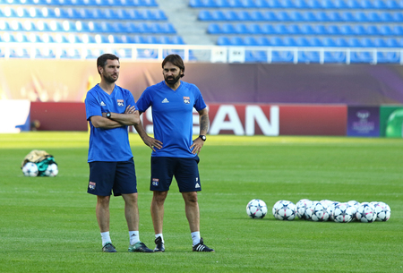 KYIV, UKRAINE - MAY 23, 2018: Head coach Reynald Pedros of Olympique Lyonnais (R) and his assistant look on during training session before UEFA Women's Champions League Final 2018 against Wolfsburg