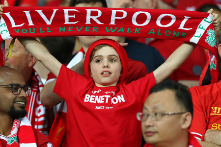 KYIV, UKRAINE - MAY 26, 2018: Young Liverpool supporter shows his support during the UEFA Champions League Final 2018 game against Real Madrid at NSC Olimpiyskiy Stadium in Kyiv